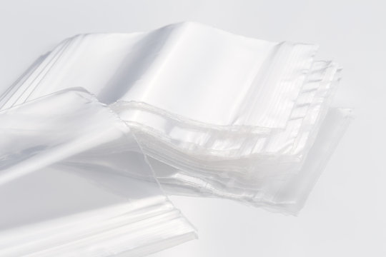 Empty transparent plastic bags on white background, reusable, re-sealable ziplock bags