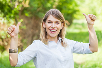 Gorgeous young lady showing thumbs up