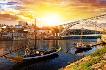 Porto, Portugal, Dom Luis bridge and boats on Douro River.