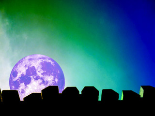 full moon silhouette of top wall and colorful sky in night