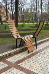 A wooden bench in the park in the spring
