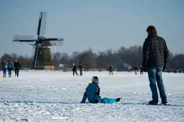 Ice skating on the frozen lakes in the Netherlands