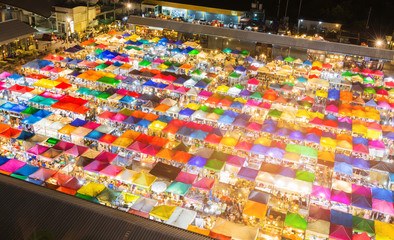 Night view multiple colour flea market, cityscape downtown background