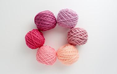 Knitting yarn balls in pink tone.