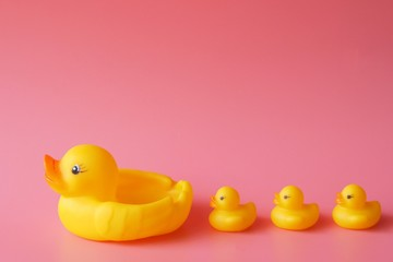 Rubber duck over pink background color