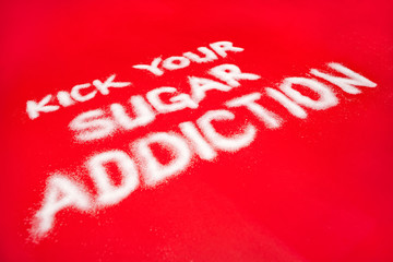 Sugar addiction concept on red background