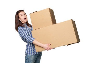 Delivery, relocation and unpacking. Expressive woman with opened mouth holding big cardboard boxes isolated on white background