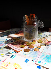 Finance background with money and pc. stacks of coins on paper currency Finance concept.