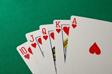 Full house poker on green background