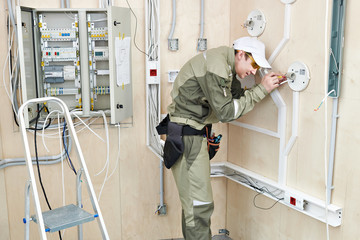 Electrician makes wiring for lighting