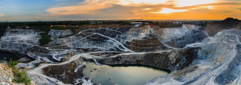 panorama of the quarry mining with beautiful sunlight and cloudy sky Aerial view industrial