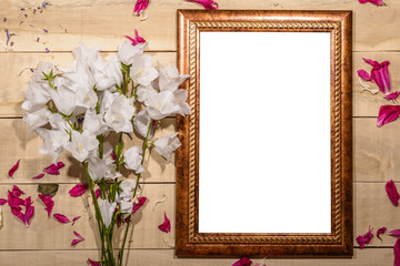 Flowers wooden frame for a picture lie on a wooden table - frame for a photo