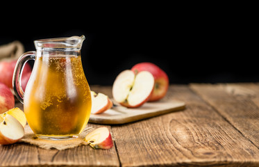 Apple Cider on wooden background (selective focus)