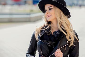 Trendy girl portrait outdoor. A walk in the city
