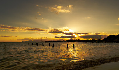 Sunset in tropical beach of Sainte Anne - Caribbean Sea - Guadeloupe tropical island