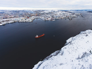 Beautiful aerial air winter vibrant view of Murmansk, Russia, a port city and the administrative center of Murmansk Oblast, Kola peninsula, Kola Bay, shot from quadcopter drone