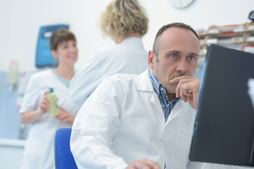 doctor looking at computer screen