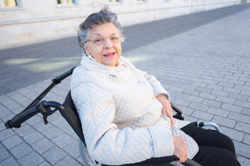 image of disabled positive old woman on wheelchair