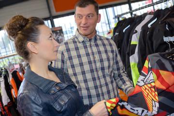 couple choosing motorcycle jackets