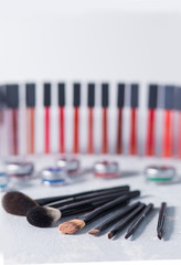 professional cosmetics, eye shadow brush, lipstick on the back white background, eye shadow, close-up