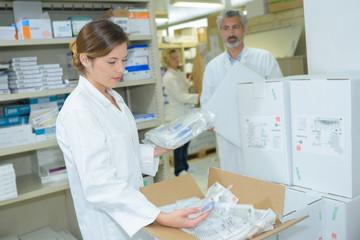 smiling european female pharmacist in drugstore