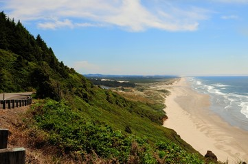 View of a long beach and coastline looking towards Florence on the Oregon Central coast, along Highway 101