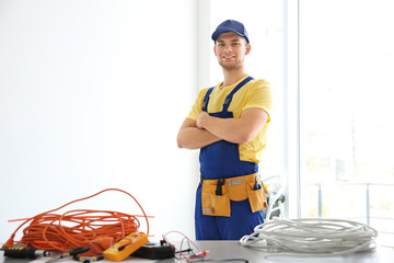 Young electrician at workplace