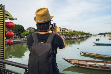 Young asian traveler with backpack at Hoi An ancient town