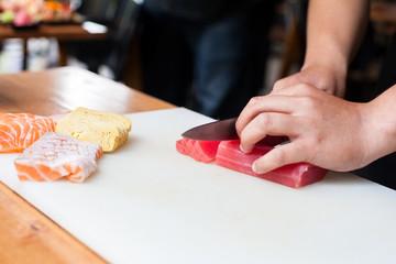 cooking fresh fish sasimi in the japanese resturenat