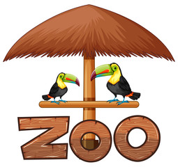 Two toucan birds under the umbrella