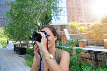 Tourist on NYC Highline taking pictures of buildings