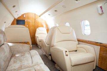 Interior in bright colors of genuine leather in the business jet