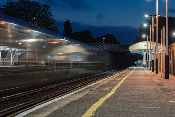 Speeding train through a UK station