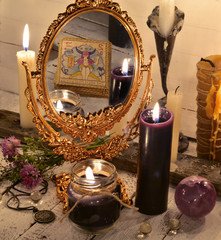 Close up with magic mirror and black candles