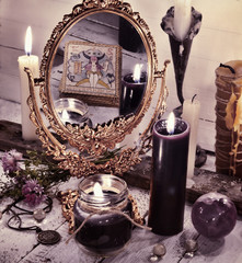 Toned still life with magic mirror and reflection of the tarot card