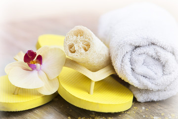Beach day, yellow slippers and natural sponge spa concept