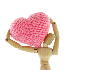 Wooden mannequin carry heart knit with yarn on the shoulder
