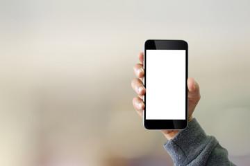 Man using smartphone on blur background.