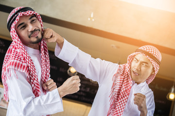 business competition concept with arabian business man fighting for the prize