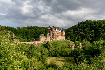 Fotobehang Kasteel Eltz Castle, a medieval castle located on a hill