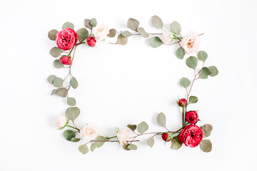 Border frame with red and beige rose flower buds and eucalyptus branches isolated on white background. Flat lay, top view. Floral background