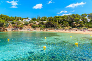 Turquoise crystal clear water of beautiful Cala Gracio beach, Ibiza island, Spain