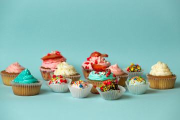 Closeup of different tasty sweets on blue background