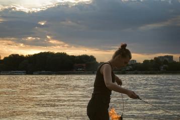 Fire Performer -  sunset fire dancing  at the beach
