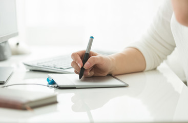 Young woman working with digital graphic tablet
