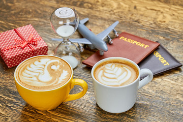 Coffee, hourglass and passports. Gift box and toy plane. Things to know about tourism.