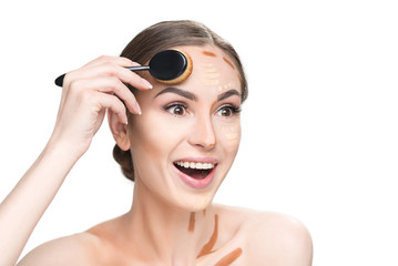 Surprised female person using cosmetic brush