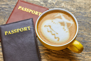 Passports and coffee cup. Latte art palm trees. Make international travel easier.