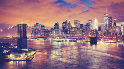 Color toned panoramic picture of New York City at night, USA..