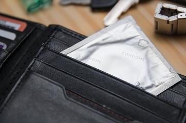 Condom in wallet, concept safe sex, male contraception